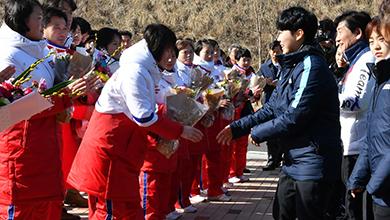 North Korean team being greeted by South Korean team