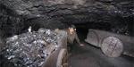Miner in rat hole mine