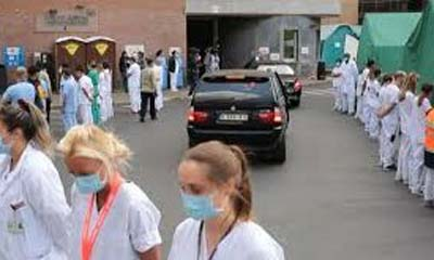 Belgian_nurses_turn_their_backs_on_PM